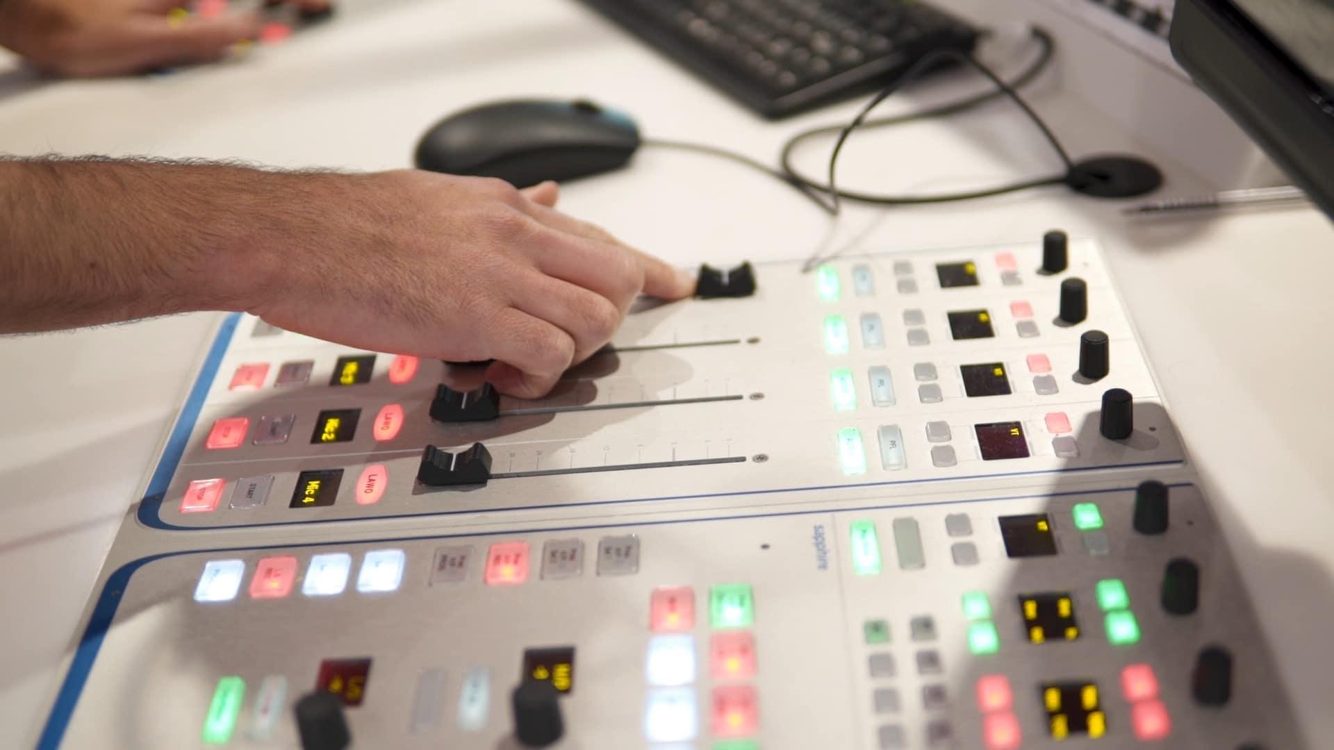 Person using radio desk in studio