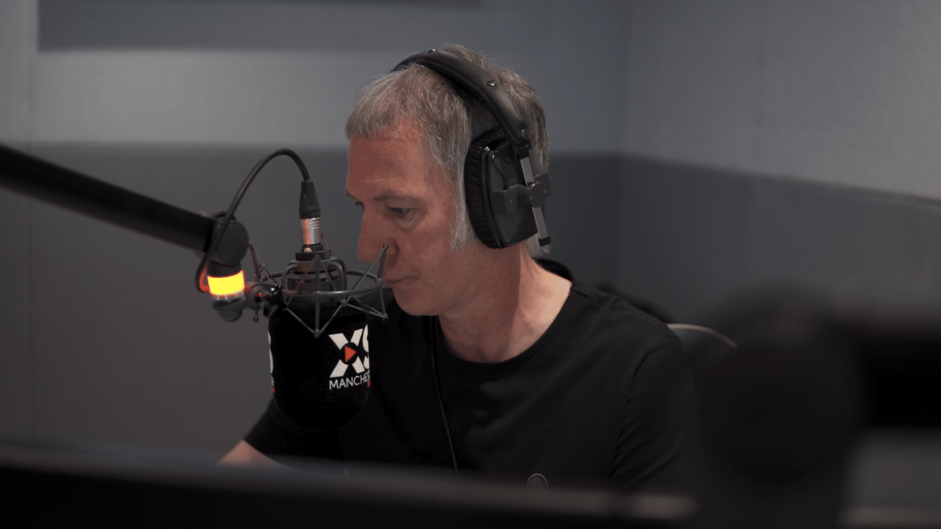 Clint Boon and microphone in studio