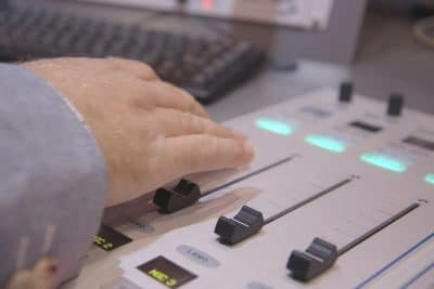 Dixie using radio desk in studio