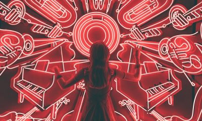 Woman stood in-front of red neon lights